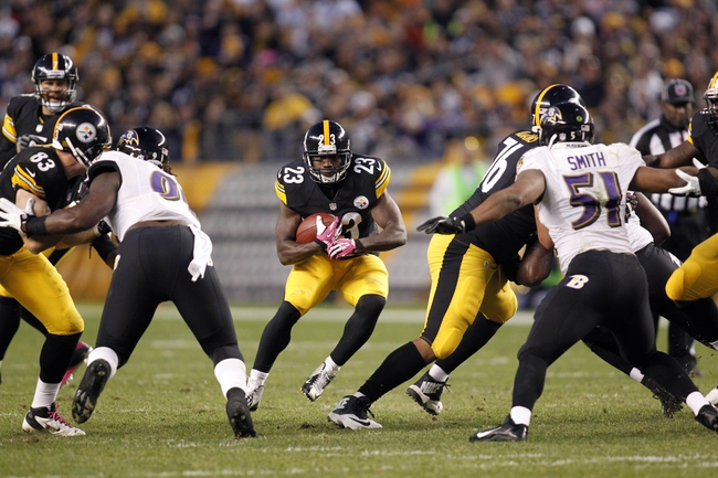 Oct 20, 2013; Pittsburgh, PA, USA; Pittsburgh Steelers running back Felix Jones (23) rushes the ball against the Baltimore Ravens during the fourth quarter at Heinz Field. The Steelers won 19-16. Mandatory Credit: Charles LeClaire-USA TODAY Sports