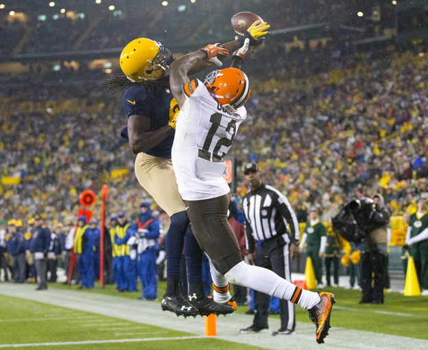 Oct 20, 2013; Green Bay, WI, USA; Green Bay Packers cornerback Davon House (31) breaks up the pass intended for Cleveland Browns wide receiver Josh Gordon (12) during the fourth quarter at Lambeau Field.  Green Bay won 31-13.  Mandatory Credit: Jeff Hanisch-USA TODAY Sports