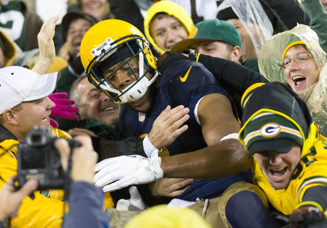 Oct 20, 2013; Green Bay, WI, USA; Green Bay Packers wide receiver Jarrett Boykin (11) celebrates a touchdown by jumping into the stands during the fourth quarter against the Cleveland Browns at Lambeau Field.  Green Bay won 31-13.  Mandatory Credit: Jeff Hanisch-USA TODAY Sports