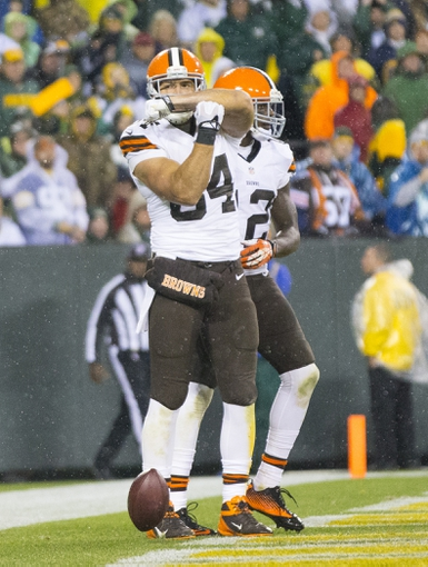 Oct 20, 2013; Green Bay, WI, USA; Cleveland Browns tight end Jordan Cameron (84) celebrates a touchdown during the fourth quarter against the Green Bay Packers at Lambeau Field.  Green Bay won 31-13.  Mandatory Credit: Jeff Hanisch-USA TODAY Sports