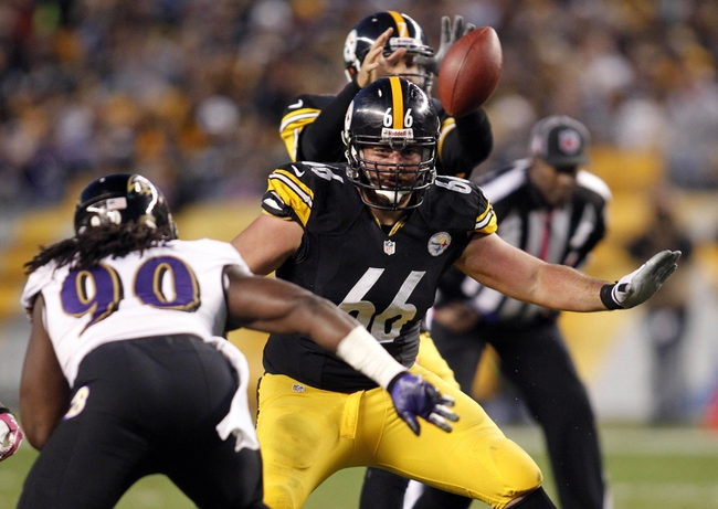 Oct 20, 2013; Pittsburgh, PA, USA; Pittsburgh Steelers guard David DeCastro (66) pass blocks against Baltimore Ravens linebacker Pernell McPhee (90) during the fourth quarter at Heinz Field. The Steelers won 19-16. Mandatory Credit: Charles LeClaire-USA TODAY Sports