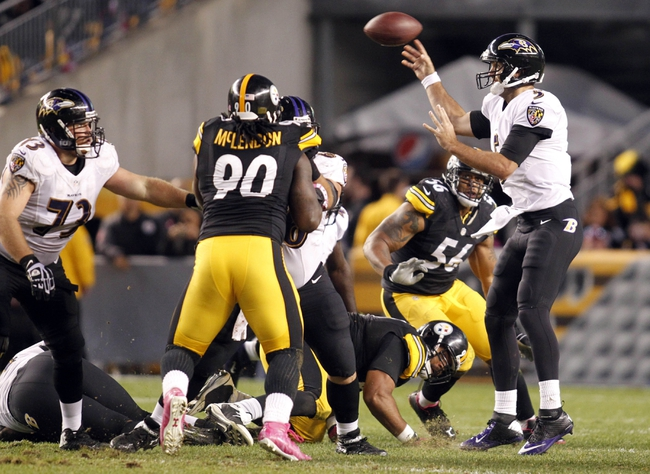 Oct 20, 2013; Pittsburgh, PA, USA; Baltimore Ravens quarterback Joe Flacco (5) throws a pass against the Pittsburgh Steelers during the fourth quarter at Heinz Field. The Steelers won 19-16. Mandatory Credit: Charles LeClaire-USA TODAY Sports
