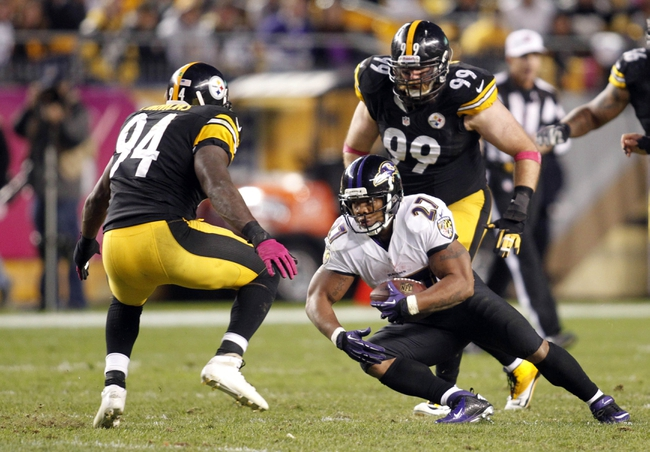 Oct 20, 2013; Pittsburgh, PA, USA; Baltimore Ravens running back Ray Rice (27) carries the ball as Pittsburgh Steelers inside linebacker Lawrence Timmons (94) and defensive end Brett Keisel (99) defend during the fourth quarter at Heinz Field. The Steelers won 19-16. Mandatory Credit: Charles LeClaire-USA TODAY Sports