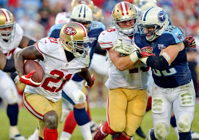 Oct 20, 2013; Nashville, TN, USA; San Francisco 49ers running back Frank Gore (21) carries the ball against the Tennessee Titans during the second half at LP Field. The 49ers beat the Titans 31-17. Mandatory Credit: Don McPeak-USA TODAY Sports
