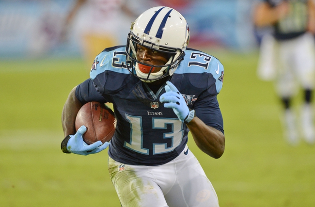 Oct 20, 2013; Nashville, TN, USA; Tennessee Titans wide receiver Kendall Wright (13) runs with the ball against the San Francisco 49ers during the second half at LP Field. The 49ers beat the Titans 31-17. Mandatory Credit: Don McPeak-USA TODAY Sports