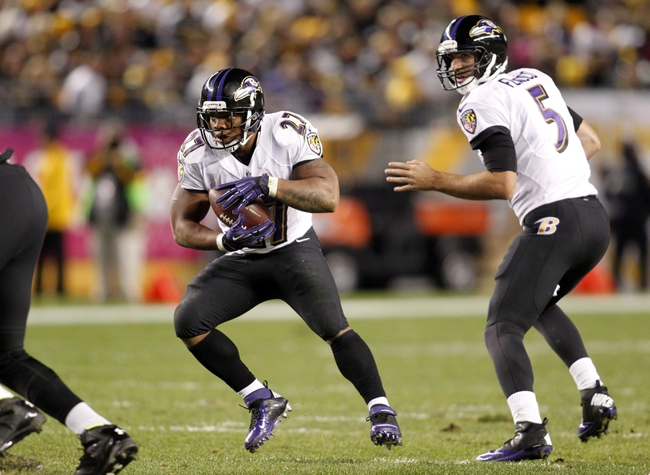 Oct 20, 2013; Pittsburgh, PA, USA; Baltimore Ravens running back Ray Rice (27) runs with the ball after taking a hand-off from quarterback Joe Flacco (5) against the Pittsburgh Steelers during the fourth quarter at Heinz Field. The Steelers won 19-16. Mandatory Credit: Charles LeClaire-USA TODAY Sports
