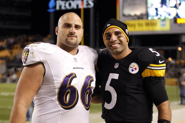 Oct 20, 2013; Pittsburgh, PA, USA; Brothers Baltimore Ravens center Gino Gradkowski (66) and Pittsburgh Steelers quarterback Bruce Gradkowski (5) pose for a photo after their game at Heinz Field. The Steelers won 19-16. Mandatory Credit: Charles LeClaire-USA TODAY Sports