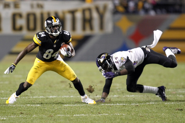 Oct 20, 2013; Pittsburgh, PA, USA; Pittsburgh Steelers wide receiver Antonio Brown (84) catches a pass as Baltimore Ravens cornerback Corey Graham (24) defends during the fourth quarter at Heinz Field. The Steelers won 19-16. Mandatory Credit: Charles LeClaire-USA TODAY Sports