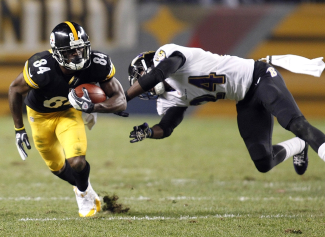 Oct 20, 2013; Pittsburgh, PA, USA; Pittsburgh Steelers wide receiver Antonio Brown (84) runs after a catch against Baltimore Ravens cornerback Corey Graham (24) during the fourth quarter at Heinz Field. The Steelers won 19-16. Mandatory Credit: Charles LeClaire-USA TODAY Sports