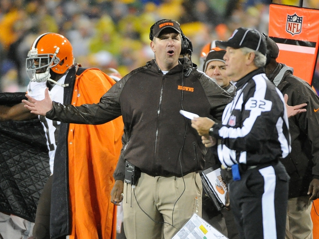 Oct 20, 2013; Green Bay, WI, USA;   Cleveland Browns head coach Rob Chudzinski argues a defensive interference call with line judge Jeff Bergman during the game against the Green Bay Packers in the 4th quarter at Lambeau Field. Mandatory Credit: Benny Sieu-USA TODAY Sports