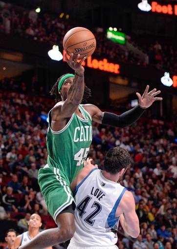 Oct 20, 2013; Montreal, Quebec, CAN; Boston Celtics forward Gerald Wallace (45) goes over Minnesota Timberwolves forward Kevin Love (42) during the third quarter at the Bell Centre. Mandatory Credit: Eric Bolte-USA TODAY Sports
