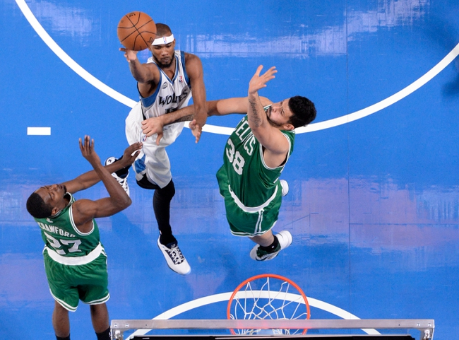 Oct 20, 2013; Montreal, Quebec, CAN; Minnesota Timberwolves forward Corey Brewer (13) shoots while Boston Celtics guard Jordan Crawford (27) and teammate center Vitor Faverani (38) defend during the third quarter at the Bell Centre. Mandatory Credit: Eric Bolte-USA TODAY Sports