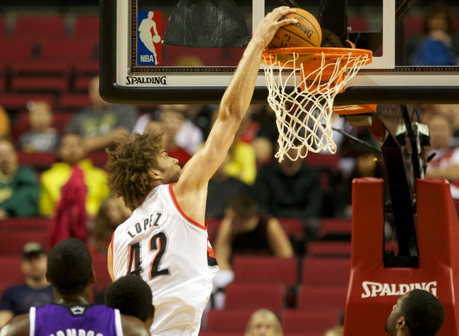 Oct 20, 2013; Portland, OR, USA; Portland Trail Blazers center Robin Lopez (42) dunks the ball against the Sacramento Kings in the first half at Moda Center. Mandatory Credit: Jaime Valdez-USA TODAY Sports