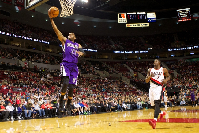 Oct 20, 2013; Portland, OR, USA; Sacramento Kings shooting guard Marcus Thornton (23) shoots a lay-up as Portland Trail Blazers shooting guard Wesley Matthews (2) looks on in the first half at Moda Center. Mandatory Credit: Jaime Valdez-USA TODAY Sports