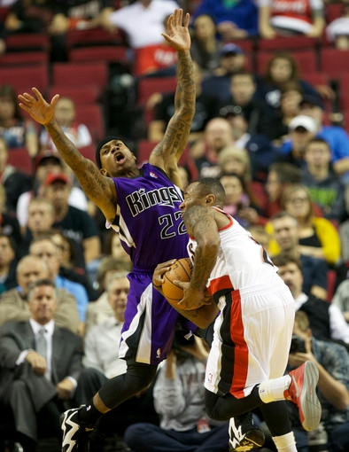 Oct 20, 2013; Portland, OR, USA; Sacramento Kings point guard Isaiah Thomas (22) reacts after being run into by Portland Trail Blazers point guard Mo Williams (25) in the first half at Moda Center. Mandatory Credit: Jaime Valdez-USA TODAY Sports