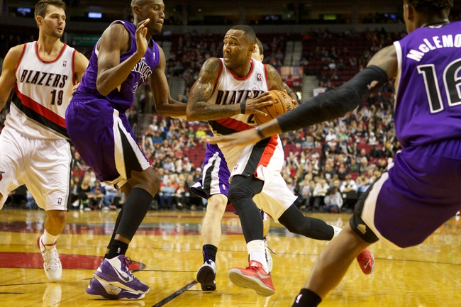 Oct 20, 2013; Portland, OR, USA; Portland Trail Blazers point guard Mo Williams (25) drives to the basket against Sacramento Kings small forward Travis Outlaw (25) in the second half at Moda Center. Mandatory Credit: Jaime Valdez-USA TODAY Sports