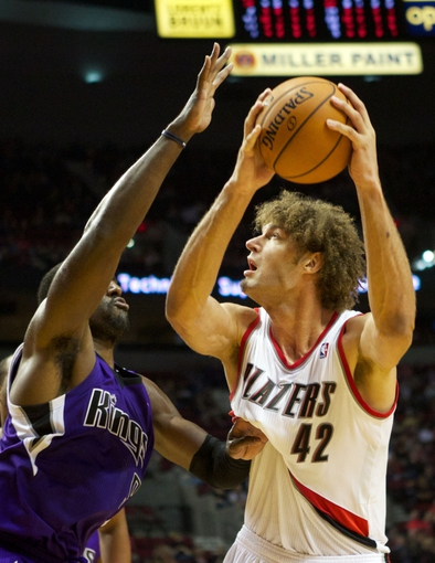Oct 20, 2013; Portland, OR, USA; Portland Trail Blazers center Robin Lopez (42) prepares to shoot over Sacramento Kings power forward Patrick Patterson (9) in the second half at Moda Center. Mandatory Credit: Jaime Valdez-USA TODAY Sports