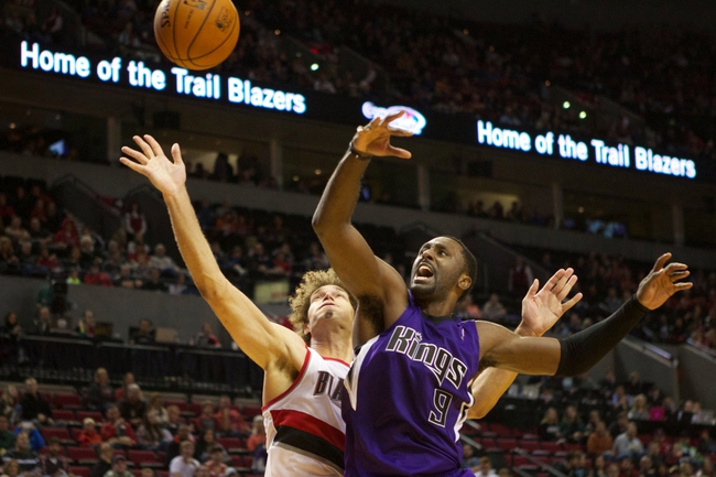 Oct 20, 2013; Portland, OR, USA; Portland Trail Blazers center Robin Lopez (42)] shoots over Sacramento Kings power forward Patrick Patterson (9) in the second half at Moda Center. Mandatory Credit: Jaime Valdez-USA TODAY Sports