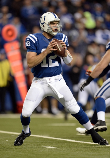 Oct 20, 2013; Indianapolis, IN, USA; Indianapolis Colts quarterback Andrew Luck (12) drops back to pass against the Denver Broncos in the fourth quarter at Lucas Oil Stadium. Mandatory Credit: Ron Chenoy-USA TODAY Sports