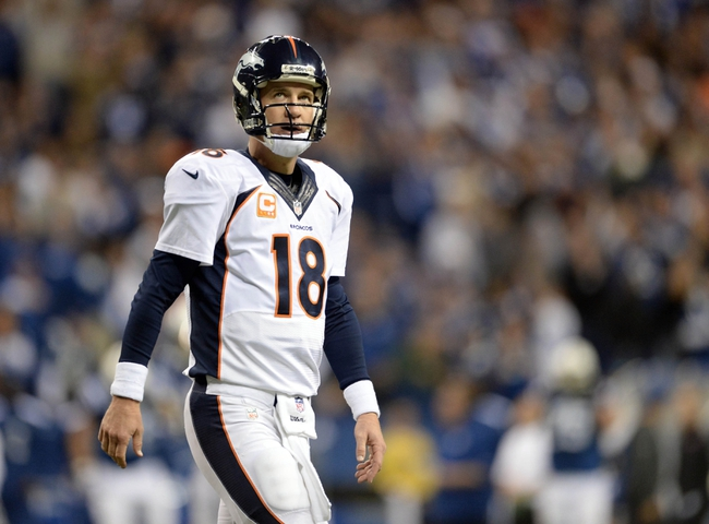 Oct 20, 2013; Indianapolis, IN, USA; Denver Broncos quarterback Peyton Manning (18) walks off the field in the fourth quarter against the Indianapolis Colts at Lucas Oil Stadium. Mandatory Credit: Ron Chenoy-USA TODAY Sports