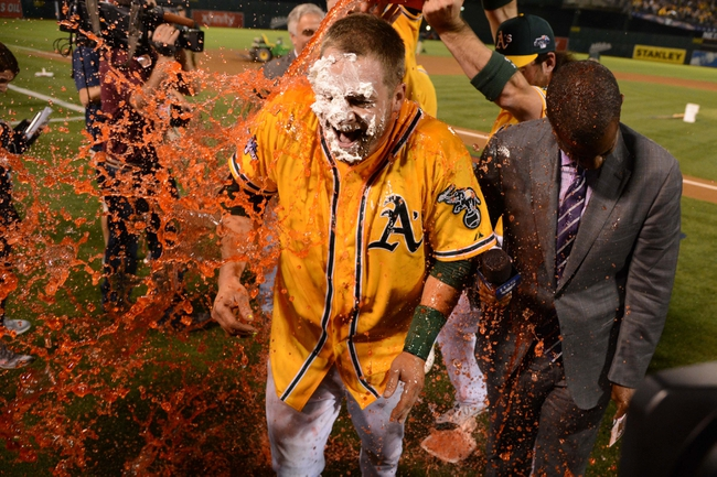 October 5, 2013; Oakland, CA, USA; Oakland Athletics catcher Stephen Vogt (21) receives a gatorade shower after game two of the American League divisional series playoff baseball game against the Detroit Tigers at O.co Coliseum. The Oakland Athletics defeated the Detroit Tigers 1-0. Mandatory Credit: Kyle Terada-USA TODAY Sports