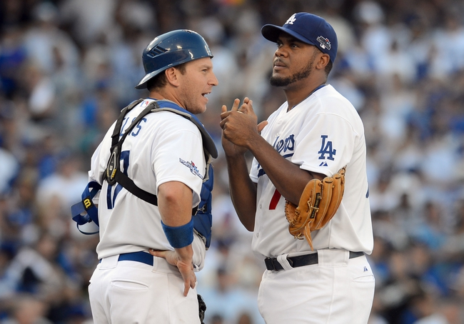 October 16, 2013; Los Angeles, CA, USA; Los Angeles Dodgers relief pitcher Kenley Jansen (74) and catcher A.J. Ellis (17) during the ninth inning of game five of the National League Championship Series baseball game against the St. Louis Cardinals at Dodger Stadium. Mandatory Credit: Jayne Kamin-Oncea-USA TODAY Sports