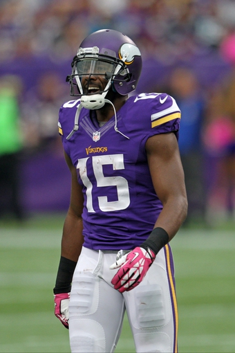 Oct 13, 2013; Minneapolis, MN, USA; Minnesota Vikings wide receiver Greg Jennings (15) against the Carolina Panthers at Mall of America Field at H.H.H. Metrodome. The Panthers defeated the Vikings 35-10. Mandatory Credit: Brace Hemmelgarn-USA TODAY Sports