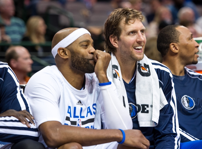 Oct 14, 2013; Dallas, TX, USA; Dallas Mavericks shooting guard Vince Carter (25) and power forward Dirk Nowitzki (41) watch the game between the Mavericks and the Orlando Magic during the game at the American Airlines Center. The Magic defeated the Mavericks 102-94. Mandatory Credit: Jerome Miron-USA TODAY Sports