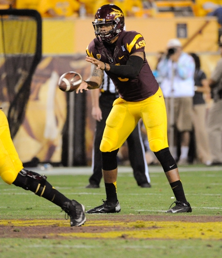 Oct 12, 2013; Tempe, AZ, USA; Arizona State Sun Devils quarterback Michael Eubank (9) takes the snap during the third quarter against the Colorado Buffaloes at Sun Devil Stadium. The Sun Devils beat the Buffaloes 54-13. Mandatory Credit: Casey Sapio-USA TODAY Sports