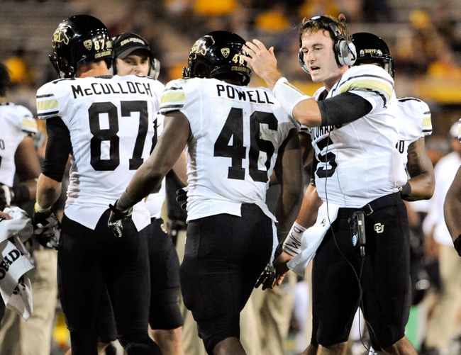 Oct 12, 2013; Tempe, AZ, USA; Colorado Buffaloes quarterback Connor Wood (5) greets running back Christian Powell (46) as he heads to the sidelines during the fourth quarter against the Arizona State Sun Devils at Sun Devil Stadium. The Sun Devils beat the Buffaloes 54-13. Mandatory Credit: Casey Sapio-USA TODAY Sports