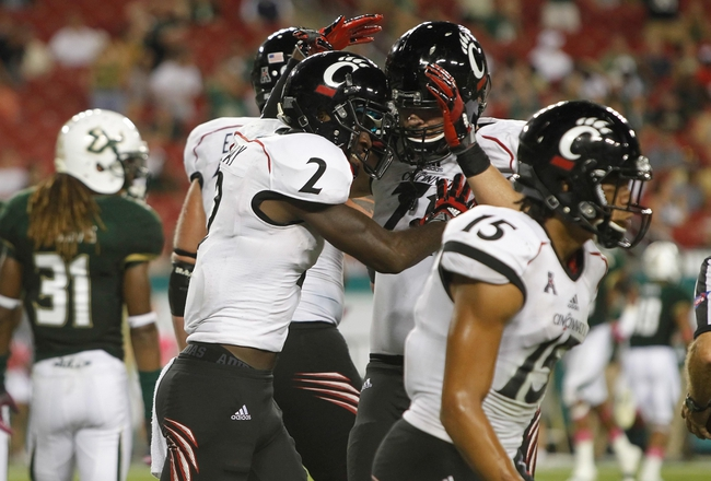 Oct 5, 2013; Tampa, FL, USA; Cincinnati Bearcats wide receiver Mekale McKay (2) is congratulated by teammates after he scored a touchdown against the South Florida Bulls  during the second half at Raymond James Stadium. South Florida Bulls defeated the Cincinnati Bearcats 26-20. Mandatory Credit: Kim Klement-USA TODAY Sports