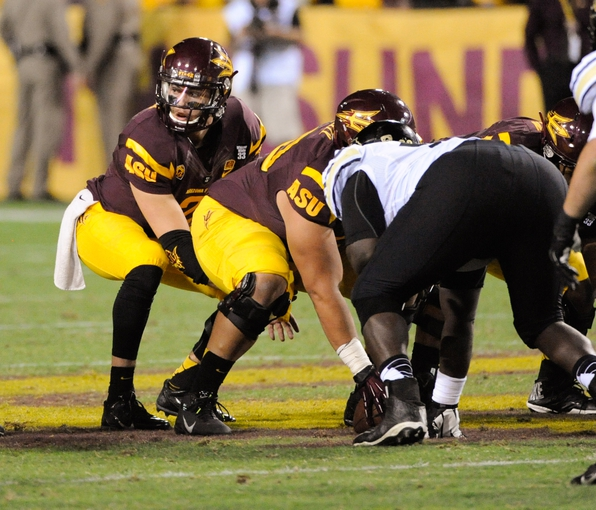Oct 12, 2013; Tempe, AZ, USA; Arizona State Sun Devils quarterback Mike Bercovici (2) under center during the third quarter against the Colorado Buffaloes at Sun Devil Stadium. The Sun Devils beat the Buffaloes 54-13. Mandatory Credit: Casey Sapio-USA TODAY Sports