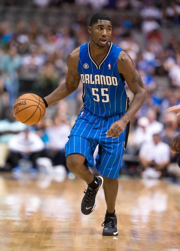 Oct 14, 2013; Dallas, TX, USA; Orlando Magic shooting guard E'Twaun Moore (55) brings the ball up court during the game against the Dallas Mavericks at the American Airlines Center. The Magic defeated the Mavericks 102-94. Mandatory Credit: Jerome Miron-USA TODAY Sports