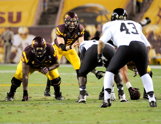 Oct 12, 2013; Tempe, AZ, USA; Arizona State Sun Devils quarterback Mike Bercovici (2) awaits the snap during the third quarter against the Colorado Buffaloes at Sun Devil Stadium. The Sun Devils beat the Buffaloes 54-13. Mandatory Credit: Casey Sapio-USA TODAY Sports