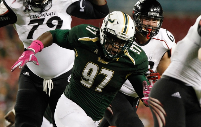 Oct 5, 2013; Tampa, FL, USA; South Florida Bulls defensive end Ryne Giddins (97) rushes against the Cincinnati Bearcats during the second half at Raymond James Stadium. South Florida Bulls defeated the Cincinnati Bearcats 26-20. Mandatory Credit: Kim Klement-USA TODAY Sports