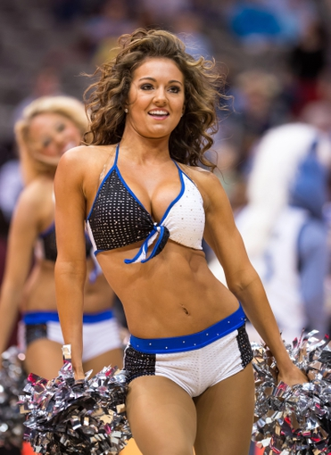 Oct 14, 2013; Dallas, TX, USA; The Dallas Mavericks dancers perform during a timeout in the game between the Mavericks and the Orlando Magic at the American Airlines Center. The Magic defeated the Mavericks 102-94. Mandatory Credit: Jerome Miron-USA TODAY Sports