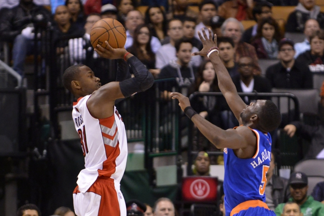 Oct 21, 2013; Toronto, Ontario, CAN; Toronto Raptors shooting guard Terrence Ross (31) makes a three point shot over New York Knicks shooting guard Tim Hardaway Jr. (5) in the first overtime period of a game at the Air Canada Centre. Toronto won the game in triple overtime123-120. Mandatory Credit: Mark Konezny-USA TODAY Sports