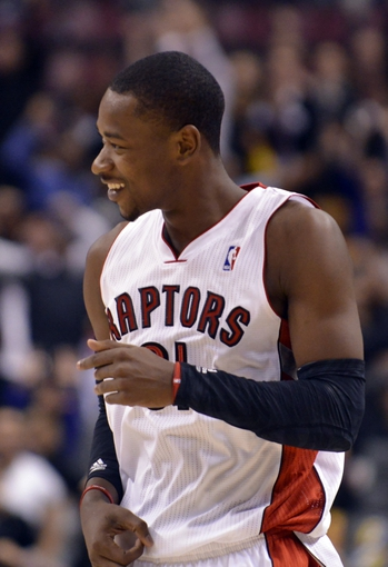 Oct 21, 2013; Toronto, Ontario, CAN; Toronto Raptors shooting guard Terrence Ross (31) reacts to making a three point shot to send the game against the New York Knicks at the Air Canada Centre into triple overtime.Toronto won the game 123-120. Mandatory Credit: Mark Konezny-USA TODAY Sports