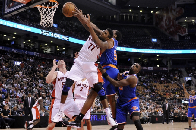 Oct 21, 2013; Toronto, Ontario, CAN; Toronto Raptors point guard Julyan Stone (77) and New York Knicks power forward Ike Diogu (50) fight for a rebound in the second half of a game at the Air Canada Centre.Toronto won the game in triple overtime123-120. Mandatory Credit: Mark Konezny-USA TODAY Sports
