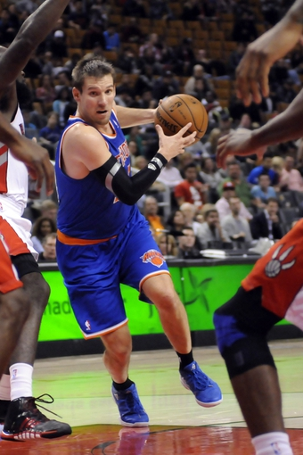 Oct 21, 2013; Toronto, Ontario, CAN; New York Knicks point guard Beno Udrih (18) drives the ball through traffic in the second half of a game against the Toronto Raptors at the Air Canada Centre.Toronto won the game in triple overtime123-120. Mandatory Credit: Mark Konezny-USA TODAY Sports