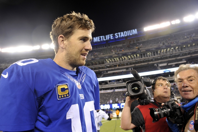 Oct 21, 2013; East Rutherford, NJ, USA; New York Giants quarterback Eli Manning (10) walks off the field after defeating the Minnesota Vikings at MetLife Stadium. The Giants won the game 23-7. Mandatory Credit: Joe Camporeale-USA TODAY Sports