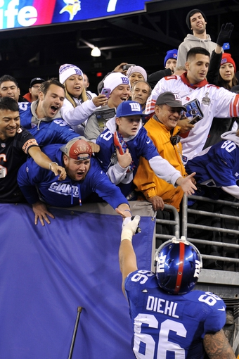 Oct 21, 2013; East Rutherford, NJ, USA; New York Giants guard David Diehl (66) shakes hands with fans after defeating the Minnesota Vikings at MetLife Stadium. The Giants won the game 23-7. Mandatory Credit: Joe Camporeale-USA TODAY Sports