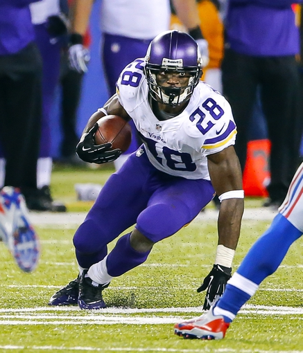 Oct 21, 2013; East Rutherford, NJ, USA;  Minnesota Vikings running back Adrian Peterson (28) runs during the second half against the New York Giants at MetLife Stadium. New York Giants defeat the Minnesota Vikings 23-7. Mandatory Credit: Jim O'Connor-USA TODAY Sports