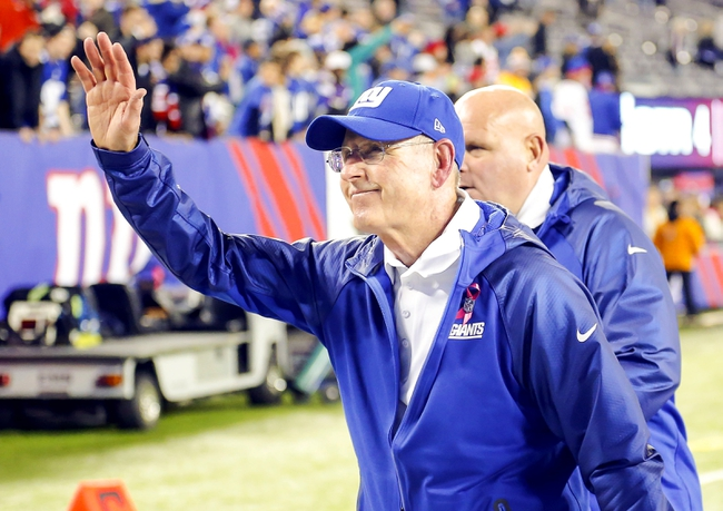 Oct 21, 2013; East Rutherford, NJ, USA;  New York Giants head coach Tom Coughlin waves to fans leaving field with victory over Minnesota Vikings at MetLife Stadium. New York Giants defeat the Minnesota Vikings 23-7. Mandatory Credit: Jim O'Connor-USA TODAY Sports
