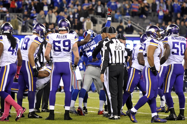 Oct 21, 2013; East Rutherford, NJ, USA; New York Giants outside linebacker Jacquian Williams (57) celebrates a fumble recovery on a kickoff return against the Minnesota Vikings during the second half at MetLife Stadium. The Giants won the game 23-7. Mandatory Credit: Joe Camporeale-USA TODAY Sports