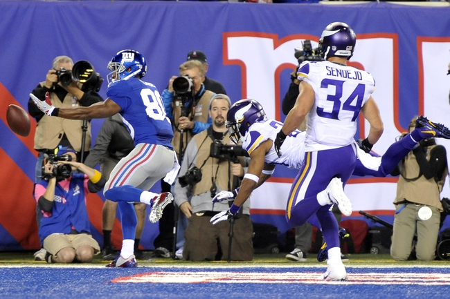 Oct 21, 2013; East Rutherford, NJ, USA; New York Giants wide receiver Victor Cruz (80) is unable to make a touchdown catch against the Minnesota Vikings during the second half at MetLife Stadium. The Giants won the game 23-7. Mandatory Credit: Joe Camporeale-USA TODAY Sports