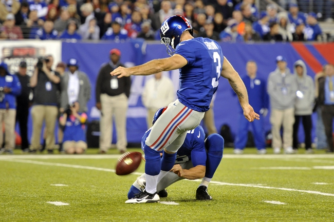 Oct 21, 2013; East Rutherford, NJ, USA; New York Giants kicker Josh Brown (3) kicks a field goal against the Minnesota Vikings during the second half at MetLife Stadium. The Giants won the game 23-7. Mandatory Credit: Joe Camporeale-USA TODAY Sports