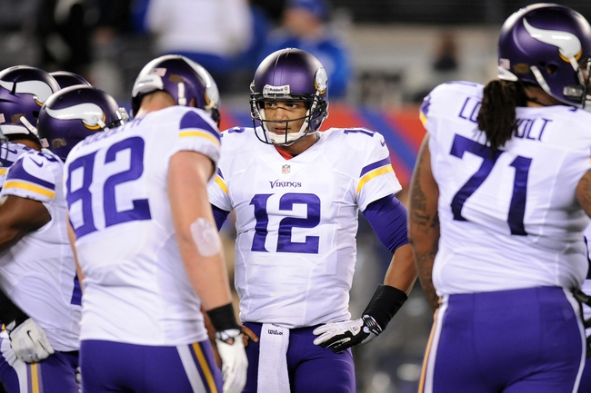 Oct 21, 2013; East Rutherford, NJ, USA; Minnesota Vikings quarterback Josh Freeman (12) huddles his offense during the final minutes of their loss to the New York Giants at MetLife Stadium. The Giants won the game 23-7. Mandatory Credit: Joe Camporeale-USA TODAY Sports