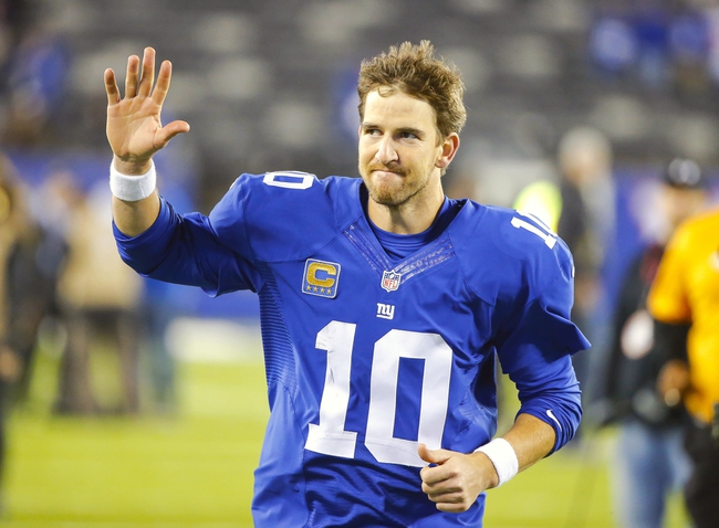 Oct 21, 2013; East Rutherford, NJ, USA;  New York Giants quarterback Eli Manning (10) waves to fans leaving the field after victory over Minnesota Vikings at MetLife Stadium. New York Giants defeat the Minnesota Vikings 23-7. Mandatory Credit: Jim O'Connor-USA TODAY Sports