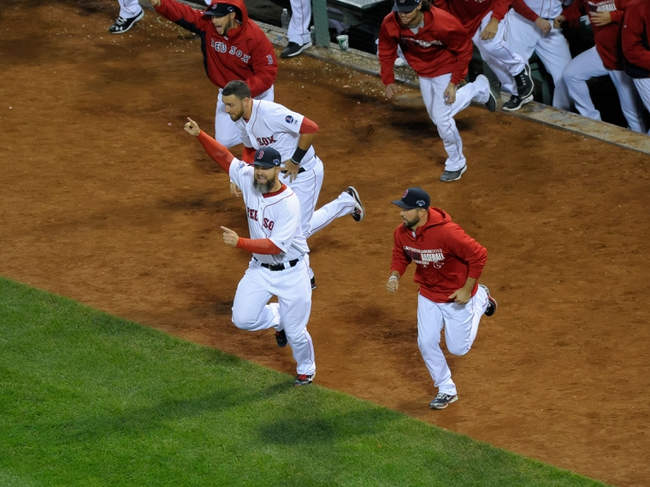 Oct 19, 2013; Boston, MA, USA; The Boston Red Sox charge the mound after defeating the Detroit Tigers during the ninth inning to win the pennant in game six of the American League Championship Series baseball game at Fenway Park. Mandatory Credit: Bob DeChiara-USA TODAY Sports